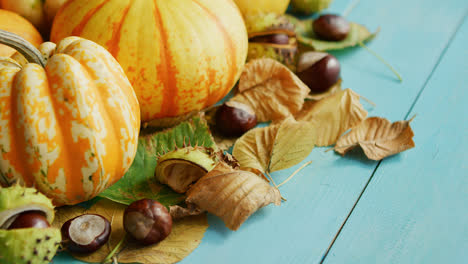 Pumpkins-decorated-with-chestnuts-and-leaves