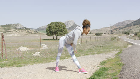 Female-stretching-during-workout-on-nature