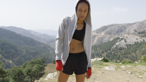 Young-relaxed-boxer-against-mountains