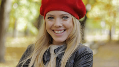 Cheerful-woman-in-red-beret