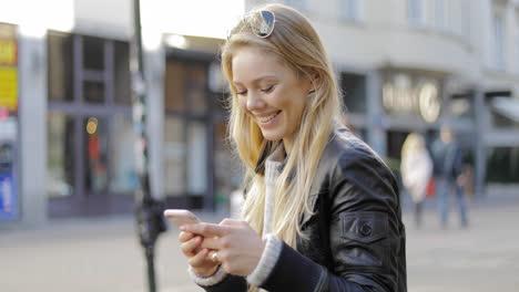 Happy-woman-using-smartphone