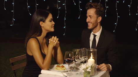 Handsome-couple-laughing-while-at-restaurant
