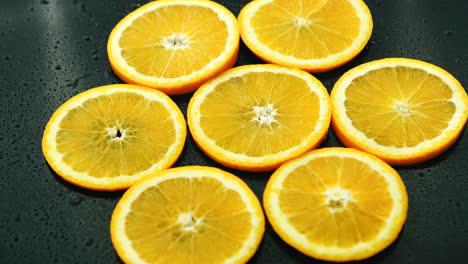 Orange-slices-on-dark-desk-