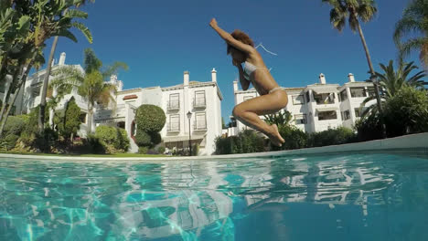 Woman-jumping-in-pool