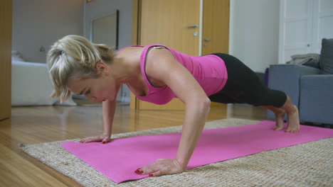 Beautiful-woman-performing-push-ups