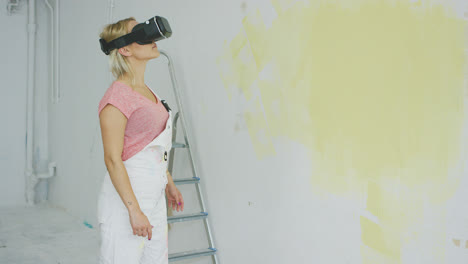 Female-in-overalls-using-virtual-reality-headset