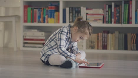 Kid-with-tablet-on-floor