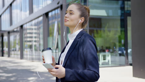 Woman-in-formal-with-smartphone-and-coffee