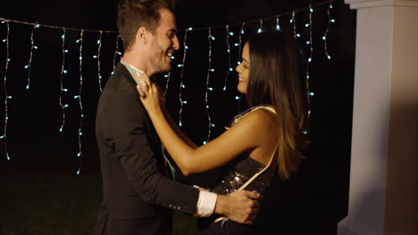 Elegant-young-couple-dancing-at-night