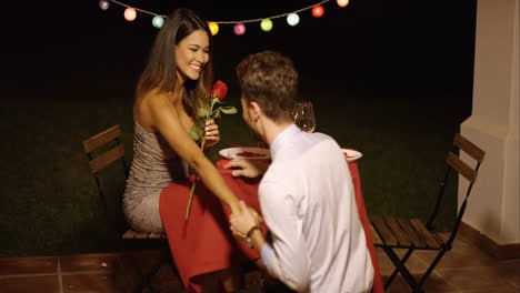Young-man-giving-a-beautiful-woman-a-rose
