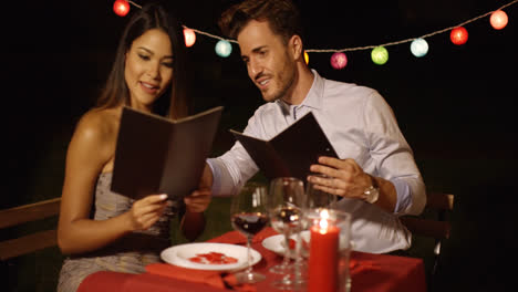 Loving-young-couple-choosing-food-off-a-menu