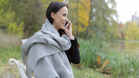 Pretty-woman-speaking-on-phone-in-park