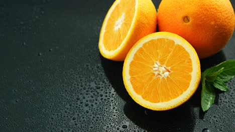 Orange-with-leaf-on-wet-table-