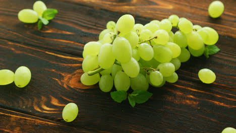 Grapes-on-branch-on-dark-table-
