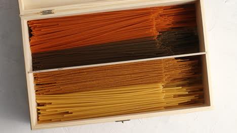 Multicolored-spaghetti-in-wood-box