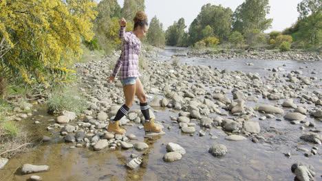 Female-tourist-walking-on-rocks