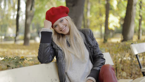 Woman-in-beret-leaning-head-on-hand
