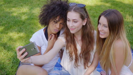 Pretty-girls-taking-selfie-on-lawn