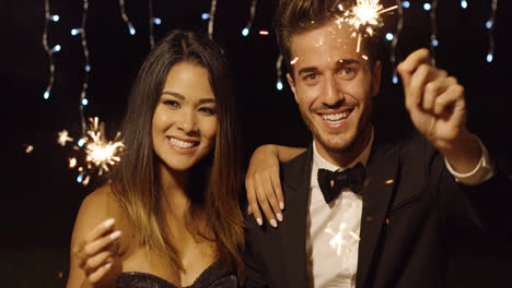 Happy-young-couple-welcoming-in-the-New-Year