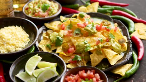 Tasty-mexican-nachos-chips-served-on-ceramic-plate