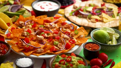 An-overhead-photo-of-an-assortment-of-many-different-Mexican-foods-on-a-table