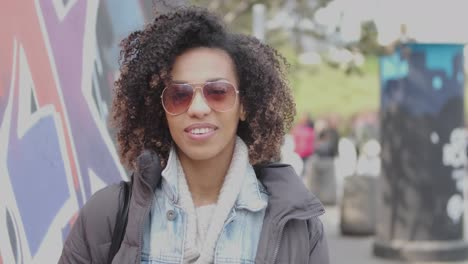 Beautiful-mixed-race-girl-with-curly-hair-posing-in-urban-city-scenery