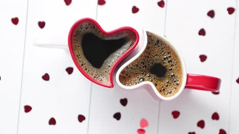 Two-heart-shaped-coffee-cups-conected-with-each-other-