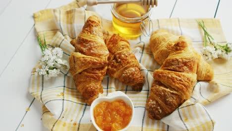 Croissants-and-condiments-composition
