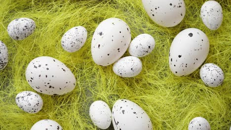 White-Easter-eggs-with-freckles-placed-on-the-yellow-hay-