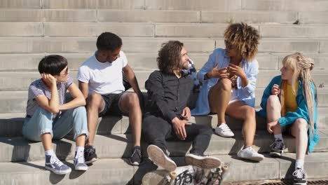 Young-stylish-friends-on-street-steps