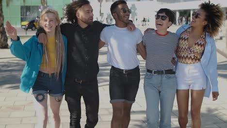 Happy-close-friends-walking-on-street