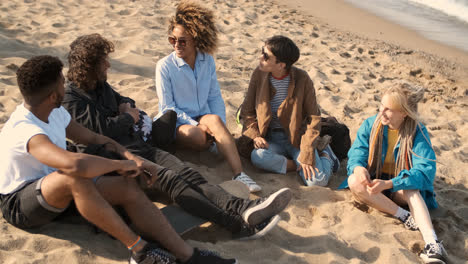 Lounging-happy-friends-on-beach