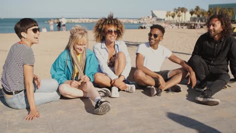 Happy-young-friends-on-city-seashore