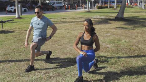 Man-showing-exercise-technique-in-park