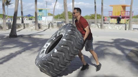Hombre-Trabajando-Con-Neumáticos