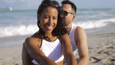 Pretty-black-girl-with-boyfriend-on-beach