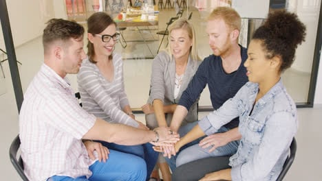Group-of-people-holding-hands-together