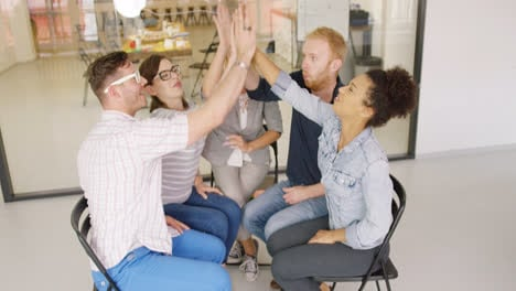 Colleagues-giving-high-five