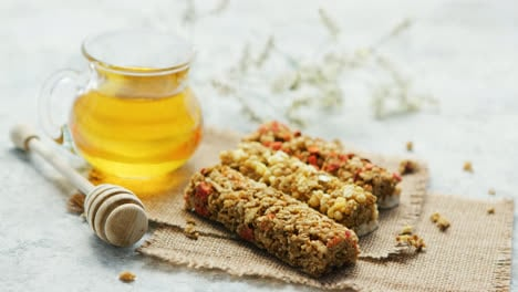 Delicious-cereal-bars-and-honey-in-jar