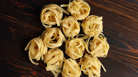 Bunches-of-raw-pasta-on-table
