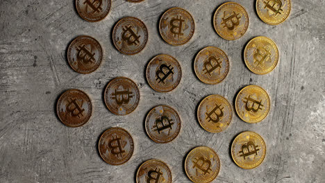 Golden-bitcoins-on-gray-surface