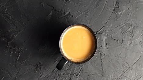 Brown-mug-with-coffee-and-milk