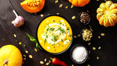 Yellow-fresh-pumpkin-soup-surrounded-by-spices-and-seeds