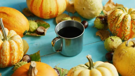 Metal-cup-of-coffee-with-pumpkins