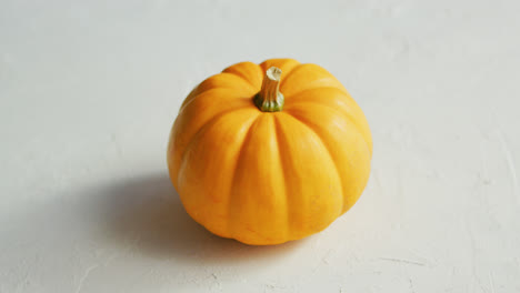 Yellow-pumpkin-laid-in-middle