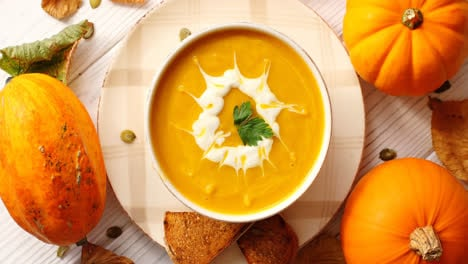 Creamy-pumpkin-soup-in-bowl-with-herb