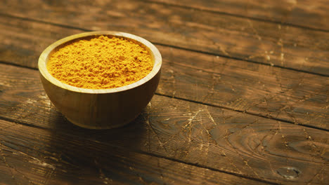 Small-bowl-of-orange-turmeric-spice