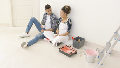 Young-couple-taking-a-break-from-renovating