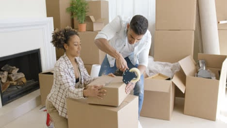 Young-couple-packing-boxes-to-move-home