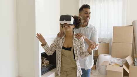 Happy-young-couple-doing-Virtual-tour-in-new-apartment
